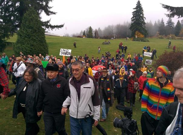 Chief Stewart Phillip of the Union of BC Indian Chiefs leads crowd of around 100 to drill site as he voluntary gets arrested, Nov 27, 2014.