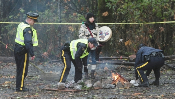 RCMP moving the sacred fire on Burnaby Mountain, Nov 21, 2014.
