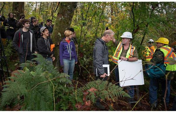 Protesters confront workers contracted by Kinder Morgan to carry out survey work on Burnaby Mountain, November 2014.