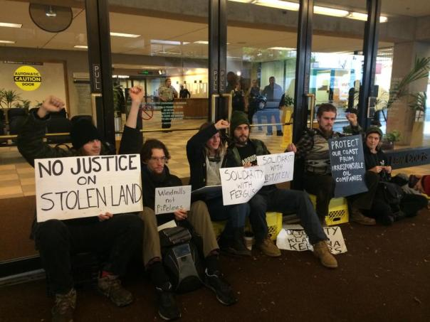 Protesters lock themselves to the doors of BC Supreme Court in Vancouver, Nov 27, 2014.