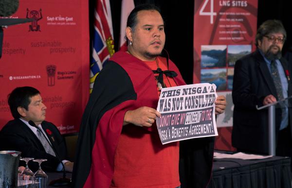Nisga'a member Grant Barton interrupts signing ceremony in Vancouver, Nov 6, 2014.