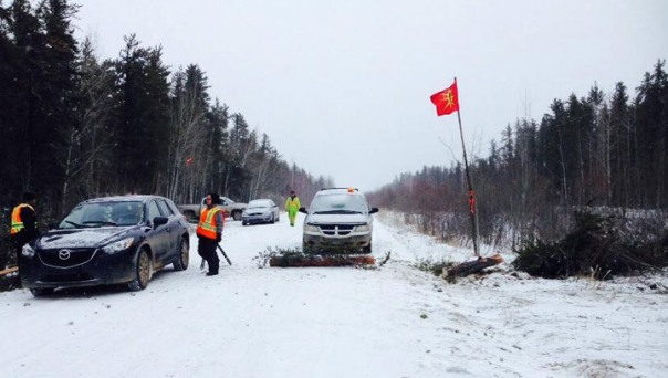 Trappers block northern Saskatchewan road, say industry must consult with them to protect the land, water, animal populations. Facebook / Holding the Line – Northern Trapper Alliance.