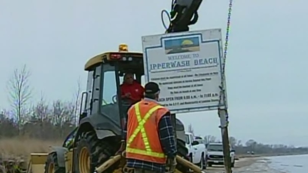 Tractor from the Kettle and Stony Point band removes gate and signage along beach, Dec 2014.