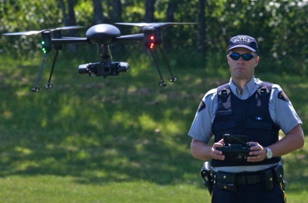 RCMP officer with Draganflyer X4-P model.