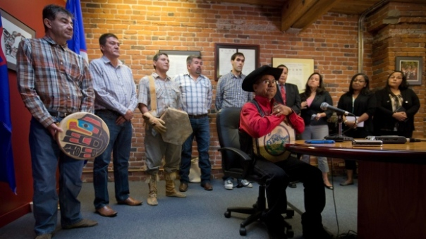 Chief Roger William, right, of the Xeni Gwet'in First Nation is flanked by chiefs and other officials as he pauses while speaking during a news conference in Vancouver after the Supreme Court of Canada ruled in favour of the Tsilhqot'in First Nation, granting it land title to 438,000 hectares of land. (Darryl Dyck/Canadian Press)
