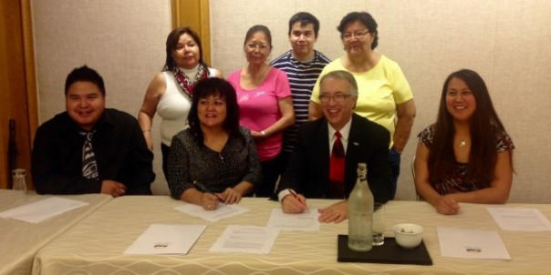 Wet'suwet'en First Nation band council sign LNG deal. Second from left is Wet'suwet'en FN chief Karen Ogen. Photo from CFNR FM