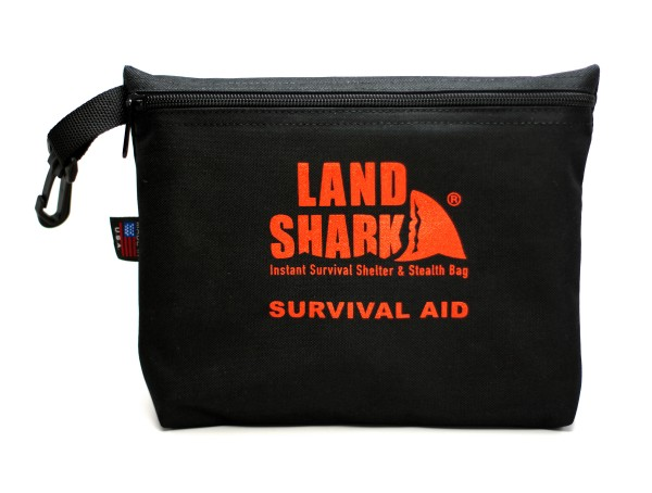 The Land Shark, an emergency bivy and rescue/stealth bag, comes in a small pouch.