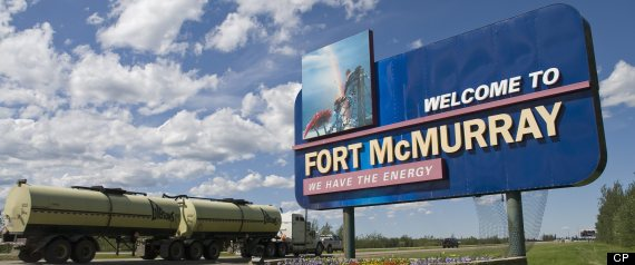 A large welcome sign greets traffic travelling north on Alberta highway 63 as it  enters the town at the centre of Canada's oil boom, Fort McMurray.File from 2006.(THE CANADIAN PRESS/Bayne Stanley)