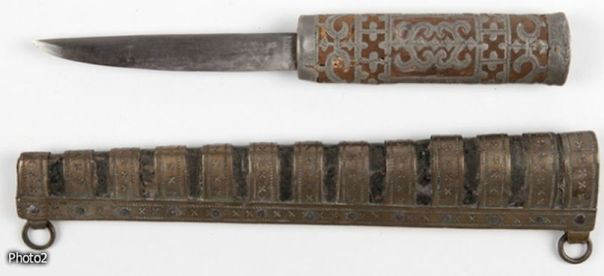An old Yakut knife (perhaps from the late 19th century, the handle decorated with metal work.