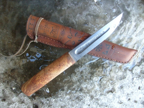 "Yakut knife by Ito Matsumoto, posted on Bladesmithforums.com, ""Blade of steel u10 (1%), hardness 58HRC, blade size 137/25/4/0.2 mm. Handle of the CAP Birch. The sheath is leather with a wooden liner. Finishing the sheath pyrography (âkutskie ornaments)."""