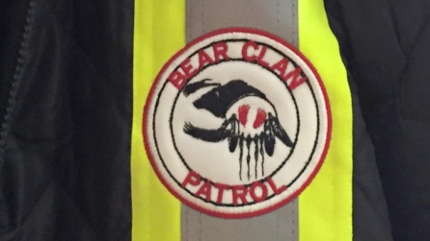 Logo on jacket of Bear Clan Patrol. Photo: CBC News.