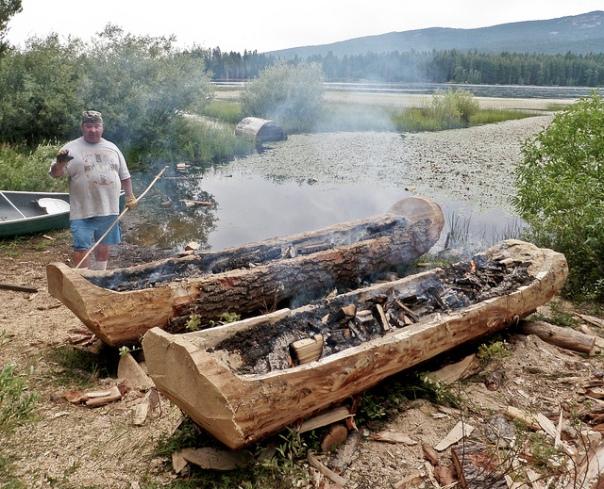 Klamath member making dug out canoes.