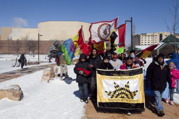 People take to the streets in Rapid City, South Dakota to protest racism, Feb 26, 2015.