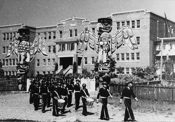 A marching band comprised of students leaves St Michael's Residential School.