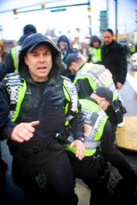 VPD arresting an unknown person, Feb 13, 2015.