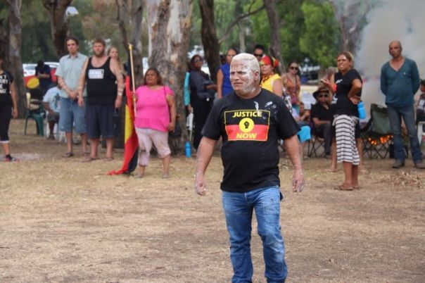 Photo: Aboriginal protesters stand their ground as police move in to clear camps at Heirisson Island. Mar 13, 2015 (ABC News: Rebecca Trigger).