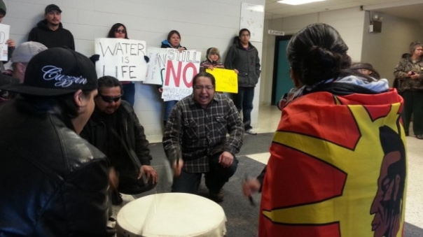 Youth leaders from Grassy Narrows First Nation opposed to clear cut logging rally inside the Ministry of Natural Resources and Forestry offices in Kenora on Monday. (Alex Hundert/Twitter)