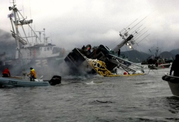 A fishing boat is capsized and nearly sinks after herring caught in net sounded (swam to the bottom), in Sitka, Alaska, April 2011.