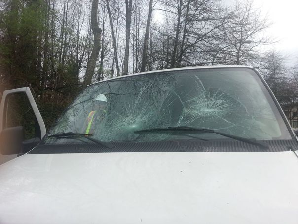 A Kinder Morgan vehicle with its windows smashed, Burnaby Mountain, March 23, 2015. Photo: Metro News.