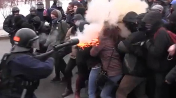 Quebec City Police fire what appears to be a Muzzle Blast round into a group of protesters outside the legislative assembly in Quebec City, March 26, 2015.