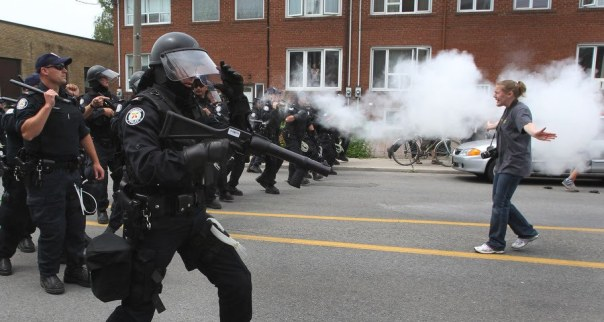 Toronto police fire a muzzle blast round at a woman during protests against the G20 in Toronto, June 27, 2010.