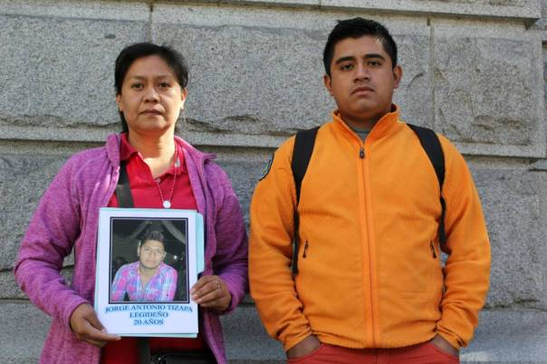 Hilda Legideño Vargas (left) holds a photo of her son, Jorge Antonio Tizapa Legideño, who was one of 43 student teachers who disappeared in Iguala, Mexico in September. She and student organizer Jorge Luis Clemente Balbuena (right) are travelling from Vancouver to Ottawa. Photo: Yolanda Cole.