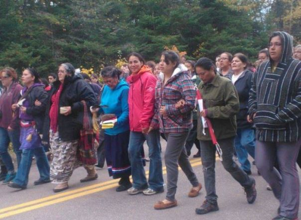Annie Clair, in centre wearing red jacket, during protests against SWN Resources and RCMP raid on Oct 17, 2013.