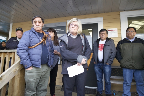 Sue Farlinger, regional DFO director (center) speaks to crowd of Heiltsuk community members gathered outside the DFO office on Denny Island, to update on negotiations about the controversial herring fishery on Monday night. Photo by Mychaylo Prystupa.