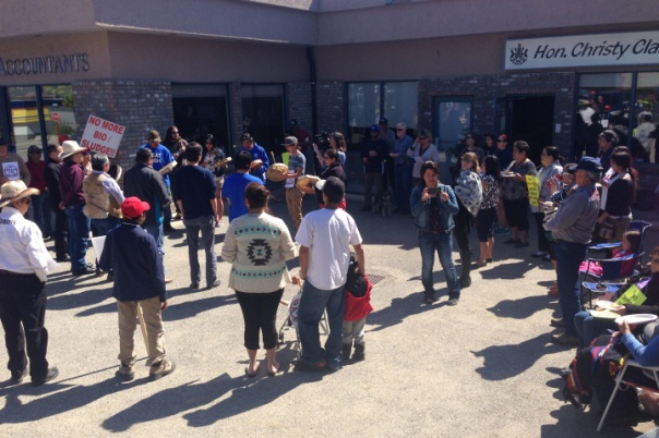 Rally against sewage disposal outside BC Premier Christy Clark's office in Kelowna, April 18, 2015.