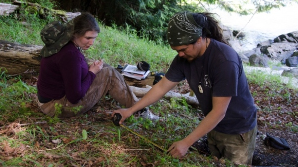 Simon Fraser University student Misha Puckett and Louie Wilson (Cape Mudge Band and Hakai Institute) excavate a shell midden associated with a clam garden that was built on a bedrock outcrop in a 2013 handout photo. (The Canadian Press)