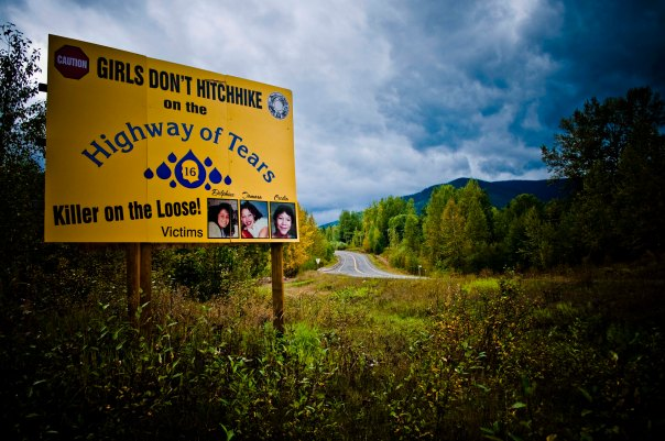 "Billboard warns against hitch hiking along Highway 16 in northern BC, also known as the ""Highway of Tears"" for the high number of missing/murdered women."