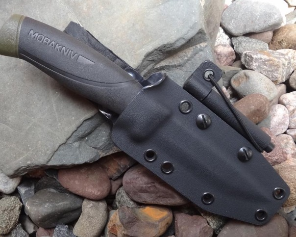 Mora Companion MG with a kydex sheath, a ferrocerium rod is attached.