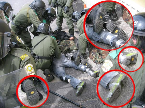 Photos showing the undercover cops wearing the same boots as the riot cops