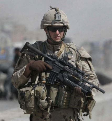 Canadian soldier in Afghanistan with a medical pouch located on his lower right side.