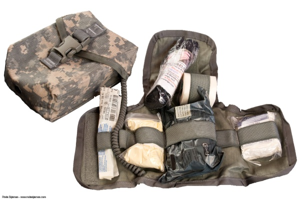 The US Army's Improved First Aid Kit (IFAK), showing the pouch and folding insert that contains the items.