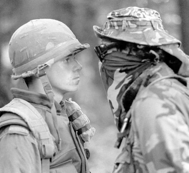 In this photo from Oka 1990, the Canadian soldier carries a field dressing on his left shoulder, attached with tape.
