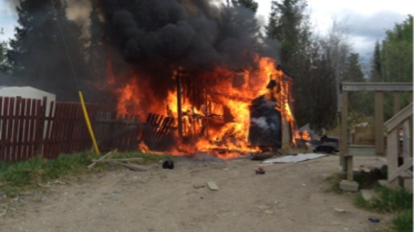 Burning shed on Nisichawayasihk Cree Nation in northern Manitoba.