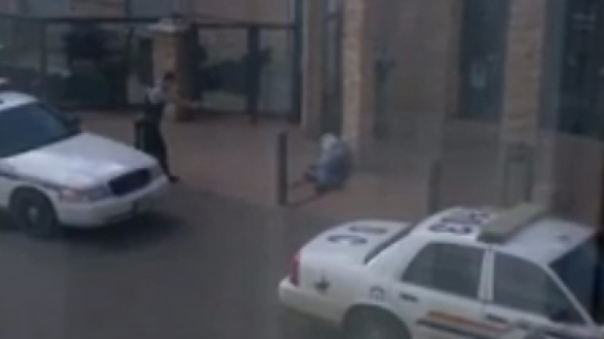 Image captured from video moments after RCMP shoot a man allegedly holding a knife in Dawson Creek, BC.