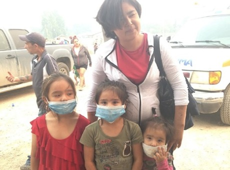 Susan and her three daughters get ready to evacuate La Ronge, Sask. Saturday. Jaydon Flett/APTN photo
