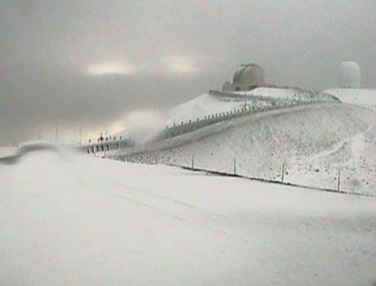 Snow fell like December in the middle of July, atop Mauna Kea, keeping the roads closed to construction. (Dustin Barca/Facebook via Indian Country Today)