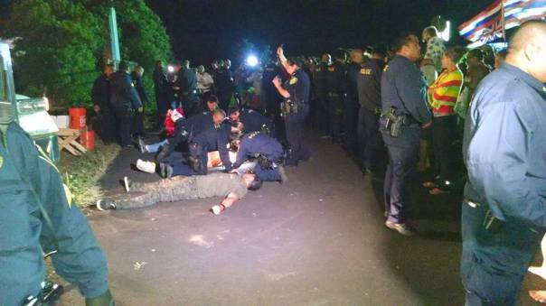 Police begin arresting protesters. Photo: Maui Now.
