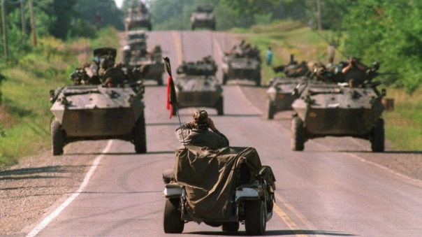 Armoured personnel carriers moving down road in Kanesatake.