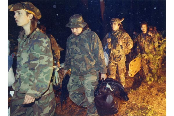 Warriors disengaging after burning their weapons, Sept 26, 1990.