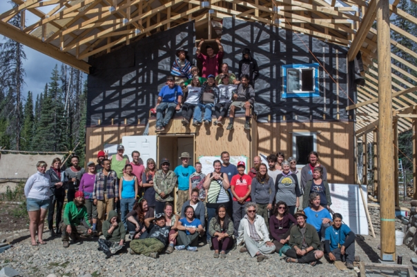Wet'suwet'en members and supporters of Unistoten camp in front of healing centre, under construction. July 2015.