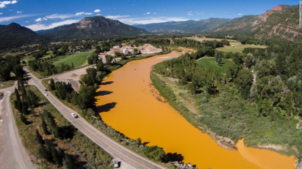 The Animas River, orange coloured as a result of contamination from gold mine waste water spill. Photo: CNN.