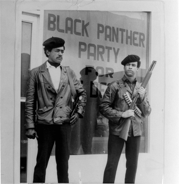 Black Panther national chairman Bobby Seale, left, wearing a Colt .45, and Huey Newton, right, defense minister with a bandoleer and shotgun are shown in Oakland, Calif., in this undated file photo. The Black Panther Party officially existed for just 16 years. Seale never expected to see the 40th anniversary of the Black Panther Party he co-founded with Huey Newton.  But its reach has endured far longer, something Seale and other party members will commemorate when they reunite in Oakland this weekend. (AP Photo/San Francisco Examiner)