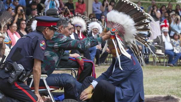 Prime Minister Stephen Harper is made an honorary chief of the Blood tribe, Standoff, Alberta, July 11, 2011.