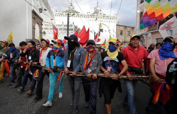 Indian protesters arrive to downtown Quito during a march called by the Confederation of Indian Nationalities of Ecuador, in Quito, Ecuador, Wednesday, Aug. 12, 2015. Demonstrators converged on the Capital from around the country and will participate in a national strike on Thursday to protest against policies of president Rafael Correa. (AP Photo/Dolores Ochoa)