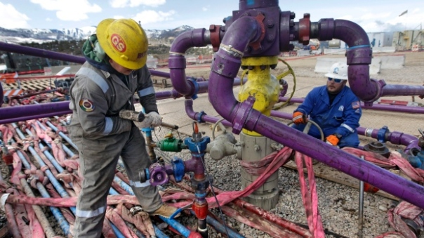 Hydraulic fracturing involves pumping water and chemicals deep into earth to fracture shale rock beds and release natural gas for extraction. (Brennan Linsley/The Associated Press)