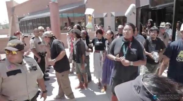 Navajo protesters look on as McCain's entourage flees. Photo: Indian Country Today.